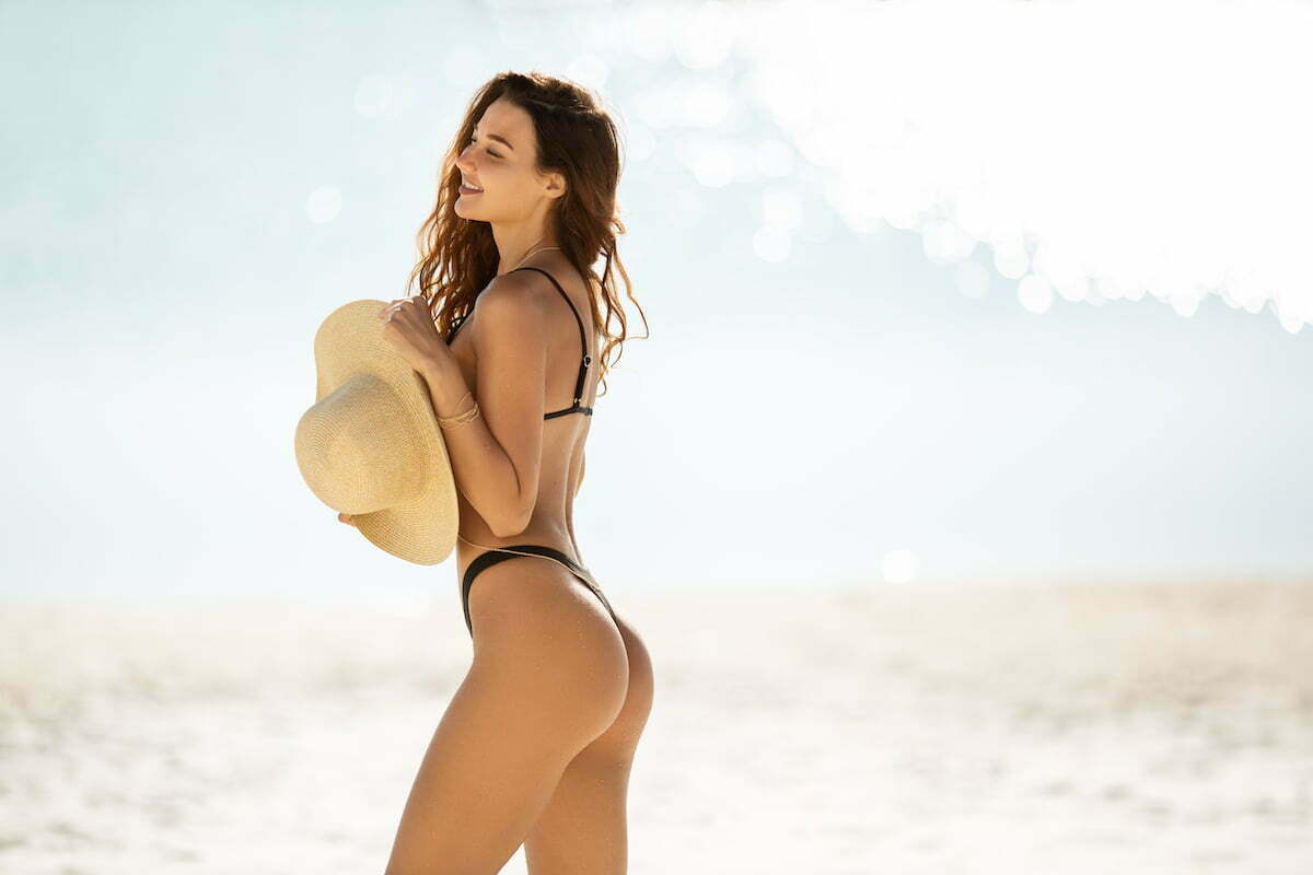 Enjoy a slim figure like this woman on a beach with emsculpt neo in northern california